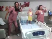Dancing Cancer Patient. Nurses dancing with a little girl!