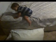 Smart Baby Throws Down Pillows On The Ground To Safely Get Off Mattress
