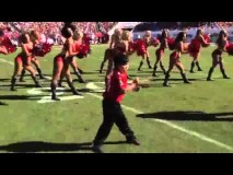 Little kid shows cheerleaders how its done
