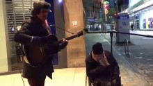 Watch when homeless man asks this street performer if he can sing with him.  Amazing!