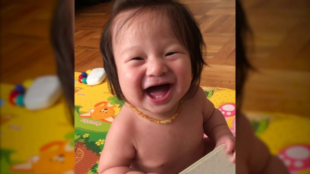 "Adorable Baby Falls over Laughing at the Word ""Boo"""