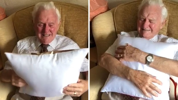 Heartwarming moment D-Day veteran tears up as he's given a pillow with a picture of his wife on it
